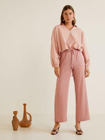 מכנסיים בהדפס פסים עם קשירה במותן של MANGO