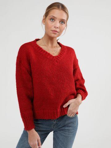 סוודר וי אוברסייז של TERMINAL X
