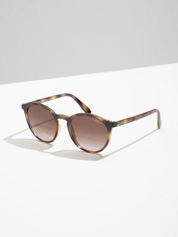 משקפי שמש עגולים עם מסגרת פלסטיק של vogue eyewear