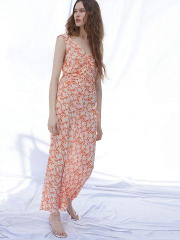 שמלת מקסי כיווצים בהדפס פרחים של URBAN OUTFITTERS
