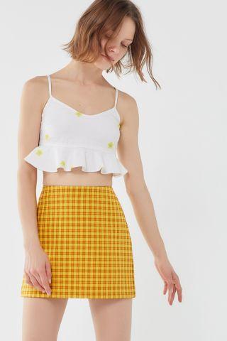 חצאית מיני בהדפס משבצות UO של URBAN OUTFITTERS
