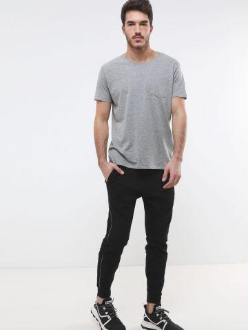 מכנסי טרנינג עם סטריפים בצדדים של FOX