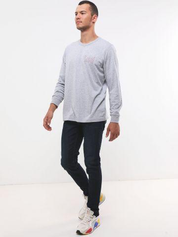ג'ינס סלים בשטיפה כהה עם שפשופים עדינים Luke של LEE
