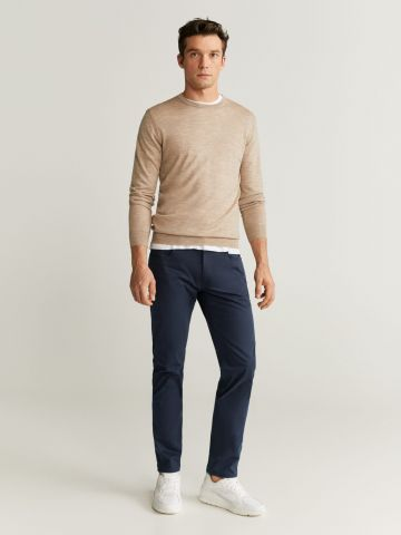 מכנסיים דמוי ג'ינס בגזרת Slim fit של MANGO