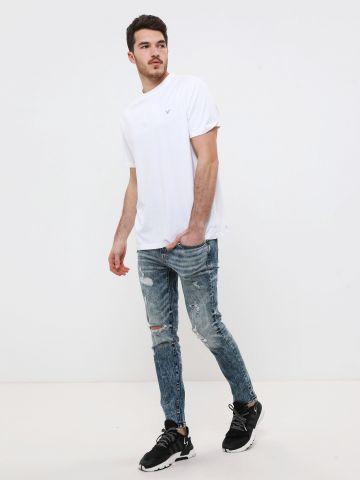 ג'ינס סקיני אסיד ווש עם קרעים של AMERICAN EAGLE