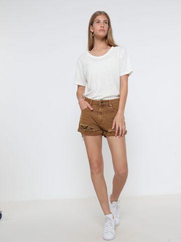 ג'ינס קצר עם קרעים וסיומת פרומה של TERMINAL X