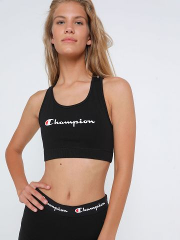 טופ ספורט לוגו עם רצועות איקס של CHAMPION