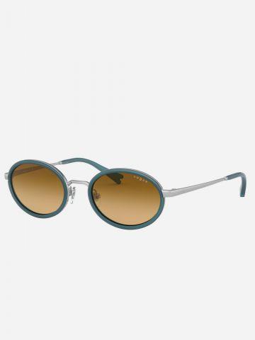 משקפי שמש עגולים עם מסגרת מתכת Milli Bobby Brown של vogue eyewear