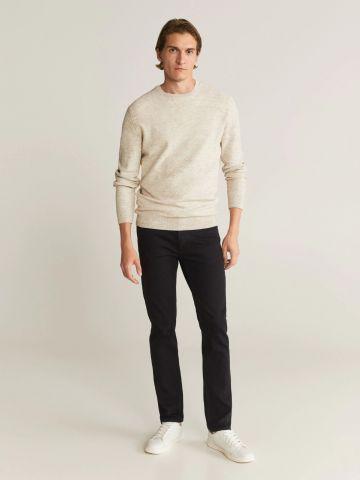 ג'ינס ארוך עם כיסים Slim-Fit של MANGO