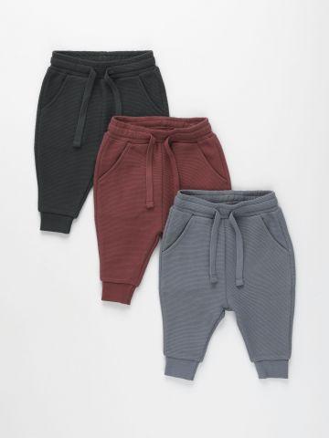 מארז 3 זוגות מכנסיים מבד טקסטורלי עם כיסים / 0-6Y של TERMINAL X KIDS