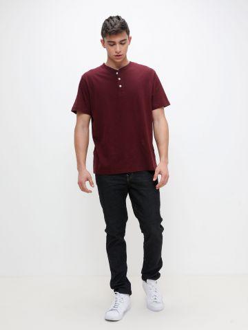 ג'ינס עם תיפורים מודגשים של AMERICAN EAGLE
