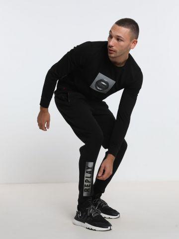 מכנסיים ארוכים עם לוגו של REPLAY