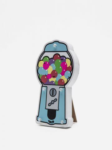 מנורת מכונת מסטיקים של YOLO