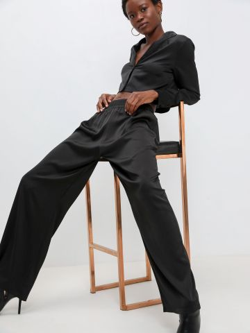 מכנסי סאטן בגזרה רחבה של KIMOR X TERMINAL X