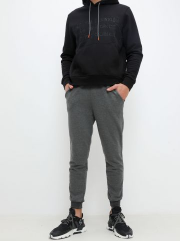 מכנסי טרנינג מלאנז' פרנץ' טרי של TERMINAL X