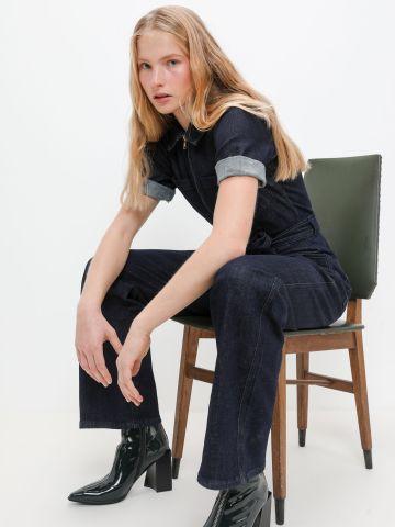 אוברול ג'ינס עם חגורה במותן של URBAN OUTFITTERS