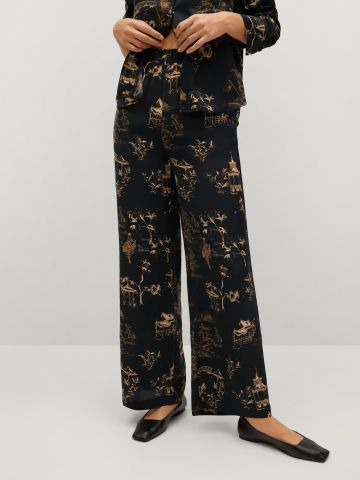 מכנסיים מתרחבים בהדפס של MANGO