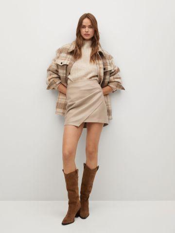 חצאית דמוי עור בסגנון מעטפת של MANGO