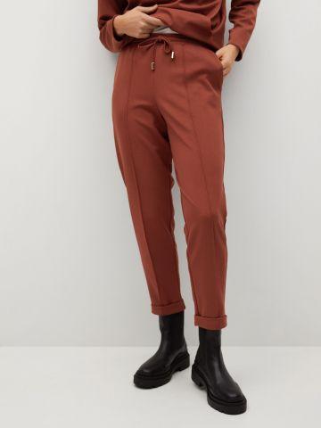 מכנסיי קרופ בסיומת קיפול של MANGO