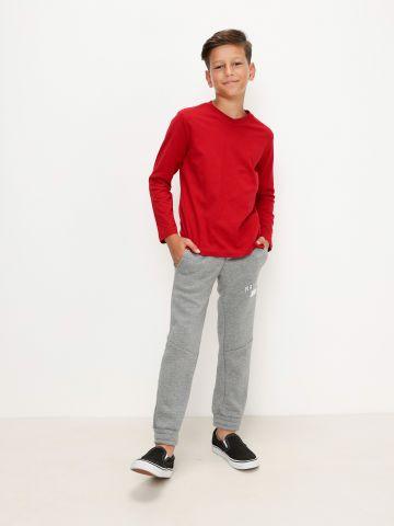 מכנסיים ארוכים עם הדפס כיתוב של FOX
