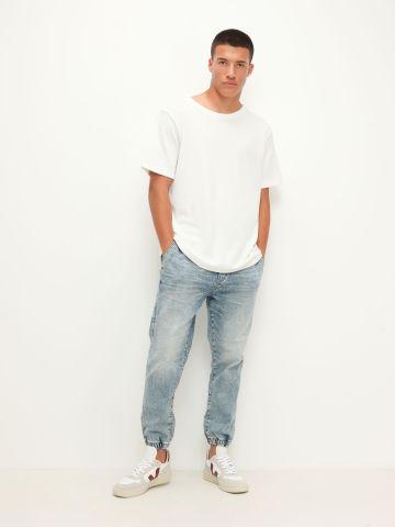 ג'ינס עם מג'נטים / גברים של AMERICAN EAGLE