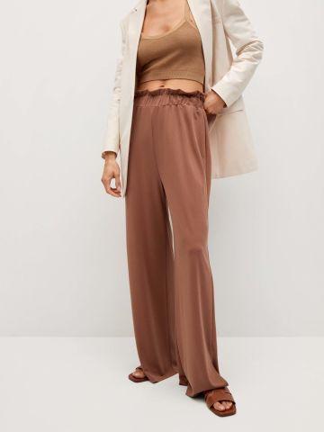 מכנסיים מתרחבים מבד נשפך של MANGO
