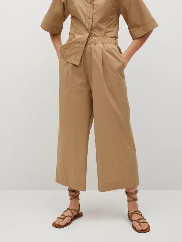מכנסיים ארוכים עם סיומת רחבה של MANGO