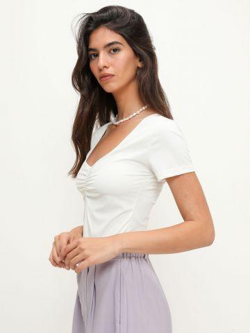 חולצת ריב בשילוב כיווצים של YANGA