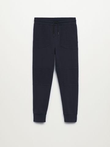 מכנסיים ארוכים בסיומת גומי / בנים של MANGO