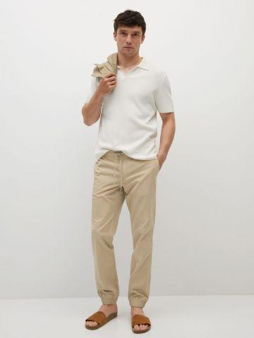 מכנסיים ארוכים עם כיסים של MANGO