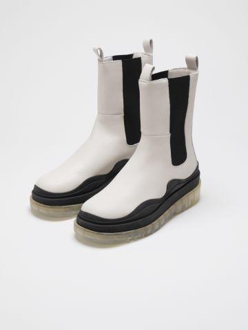 מגפיים מעור עם סוליית פלטפורמה של STEVE MADDEN