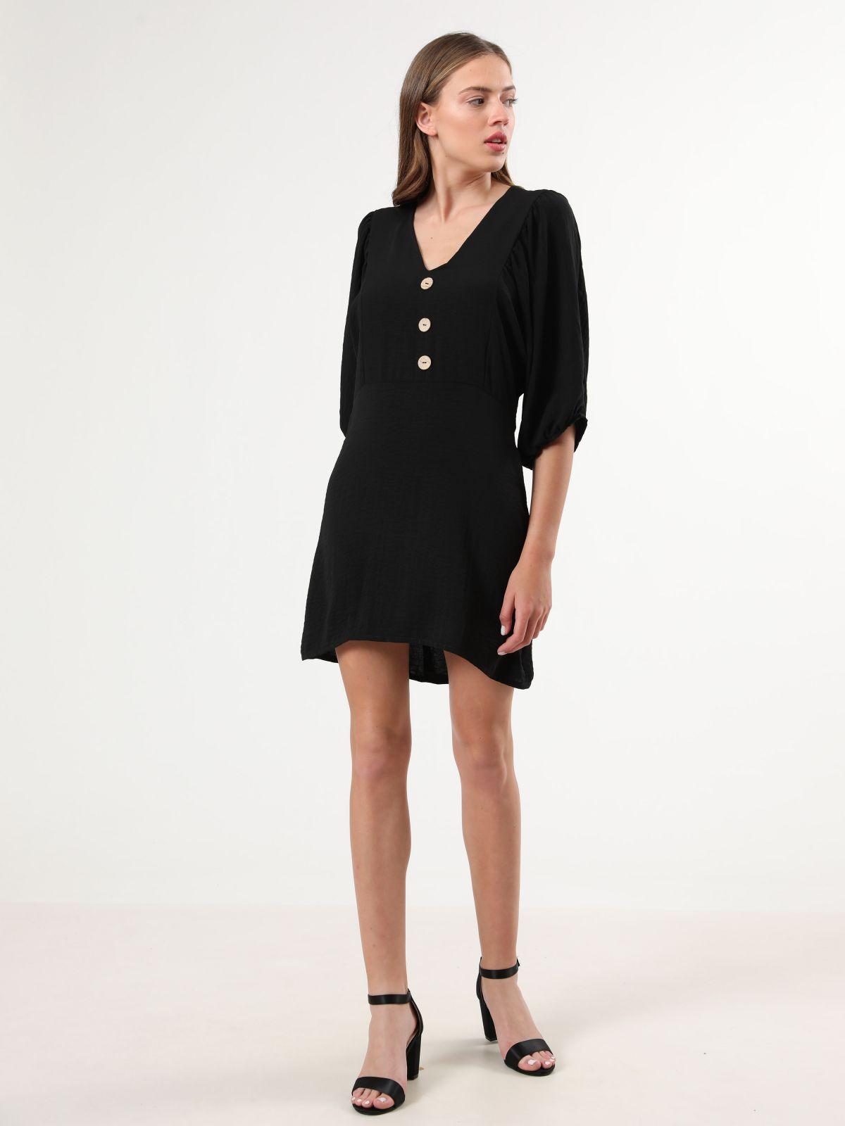 שמלת מיני עם שרוולי 3/4 נפוחיםשמלת מיני עם שרוולי 3/4 נפוחים של YANGA