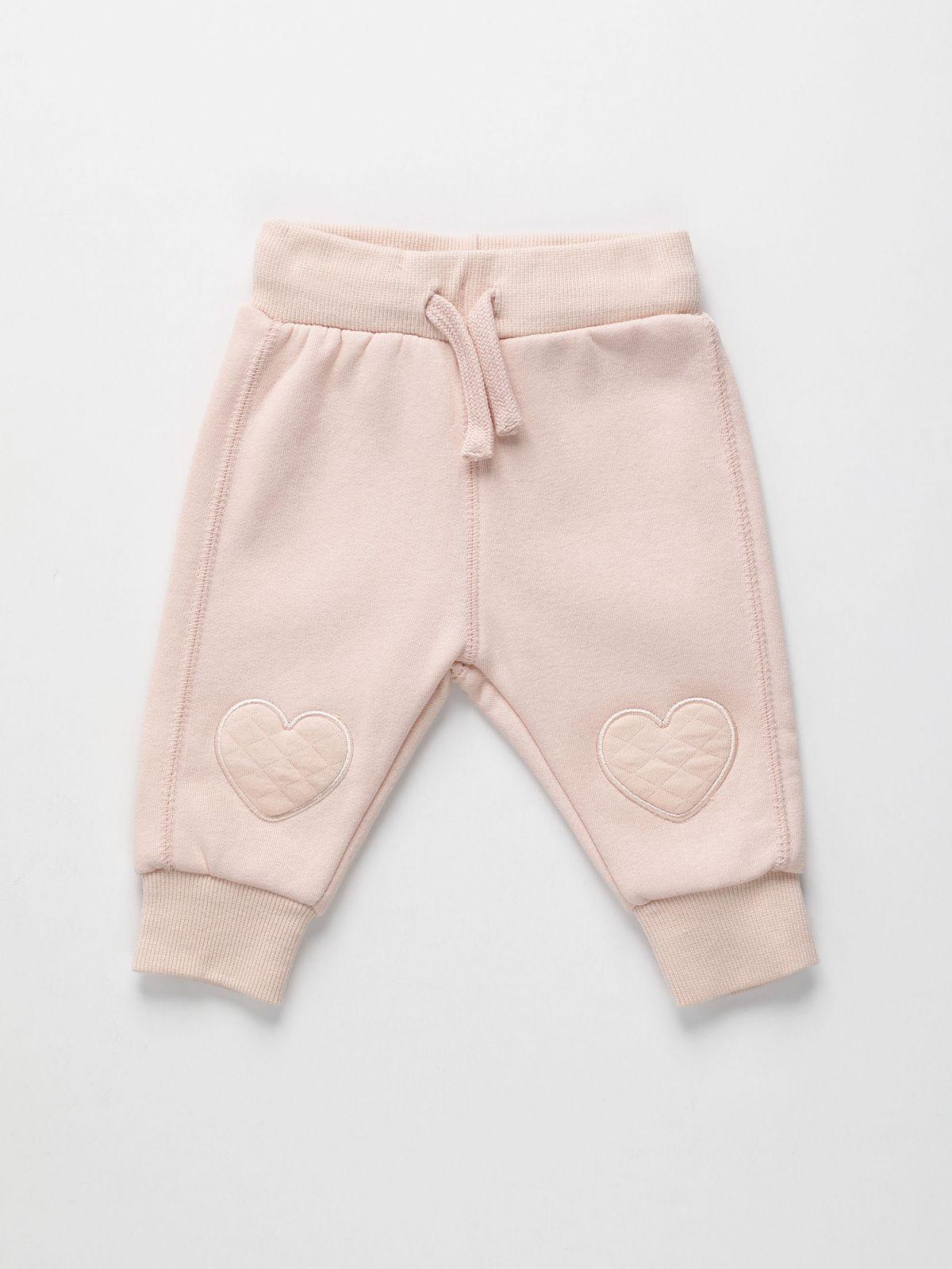 מכנסי טרנינג עם ברכיית לב / 0-3Yמכנסי טרנינג עם ברכיית לב / 0-3Y של FOX
