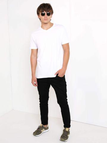 מכנסי ג'ינס גזרה ישרה של WRANGLER