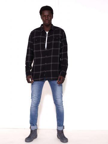 מכנסי ג'ינס סקיני בשטיפת אסיד -וואש Malone Mid Light