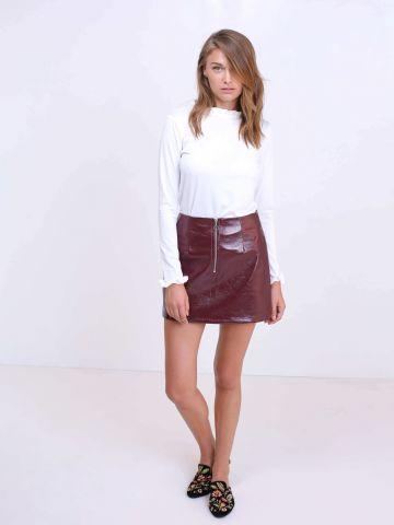 חצאית עם רוכסן קדמי