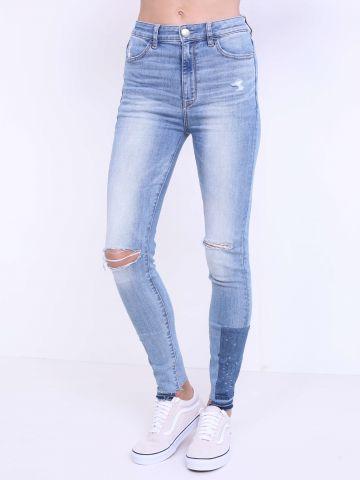 מכנסי ג'ינס קרעים ופאץ'