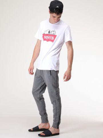 מכנסי טרנינג סקיני עם פאנלים ריב