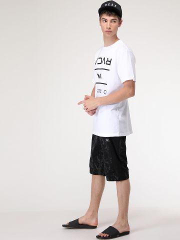 מכנסי טרי ברמודה בהדפס צבע מתפשט