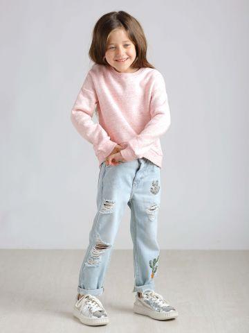 ג'ינס עם קרעים ופאטצ'ים של קקטוס