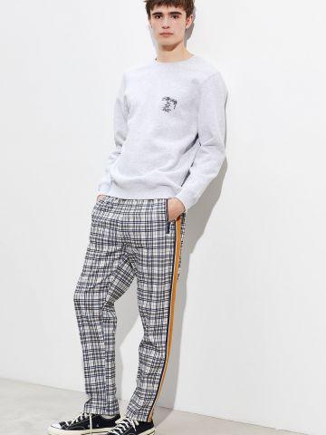 מכנסי טראק רחבים בהדפס גאומטרי UO