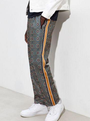 מכנסי טראק רחבים בהדפס ריבועי פייסלי UO