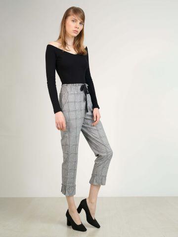 מכנסיים משובצים עם סיומת מלמלה