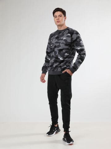 מכנסי טרנינג עם עם גימורי תפרים בולטים Tech Fleece