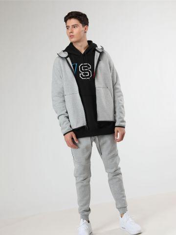 מכנסי טרנינג לוגו עם תפרים בברכיים Tech Fleece
