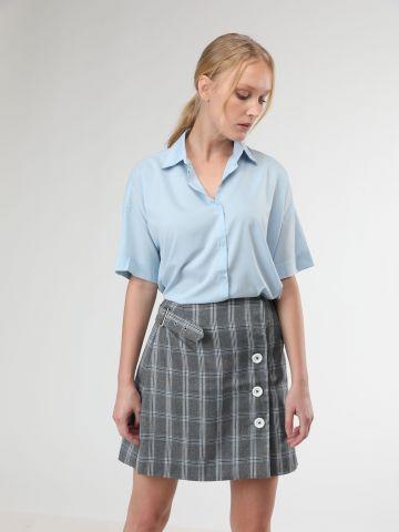 חצאית מיני מעטפת משבצות בשילוב כפתורים