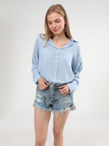 ג'ינס קצר בעיטור כתמי צבע וסיומת פרומה