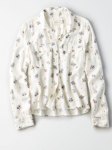 חולצה מכופתרת בהדפס פרחים עם כיסים / נשים