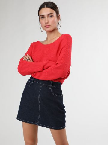 חצאית מיני ג'ינס בגזרה גבוהה