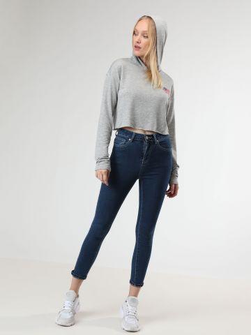 ג'ינס סקיני סטרץ' עם תיפורים בהירים בגזרה גבוהה